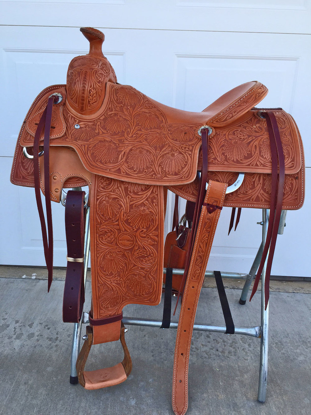 "NEW!!!  Jeff Smith's Custom Saddles   CUSTOM MADE 16"" Low association tree with 16"" seat and a flat plate rigging. Full tooled Poinsettia pattern. The saddle is new and has never been ridden. Cowboy saddle deluxe!"