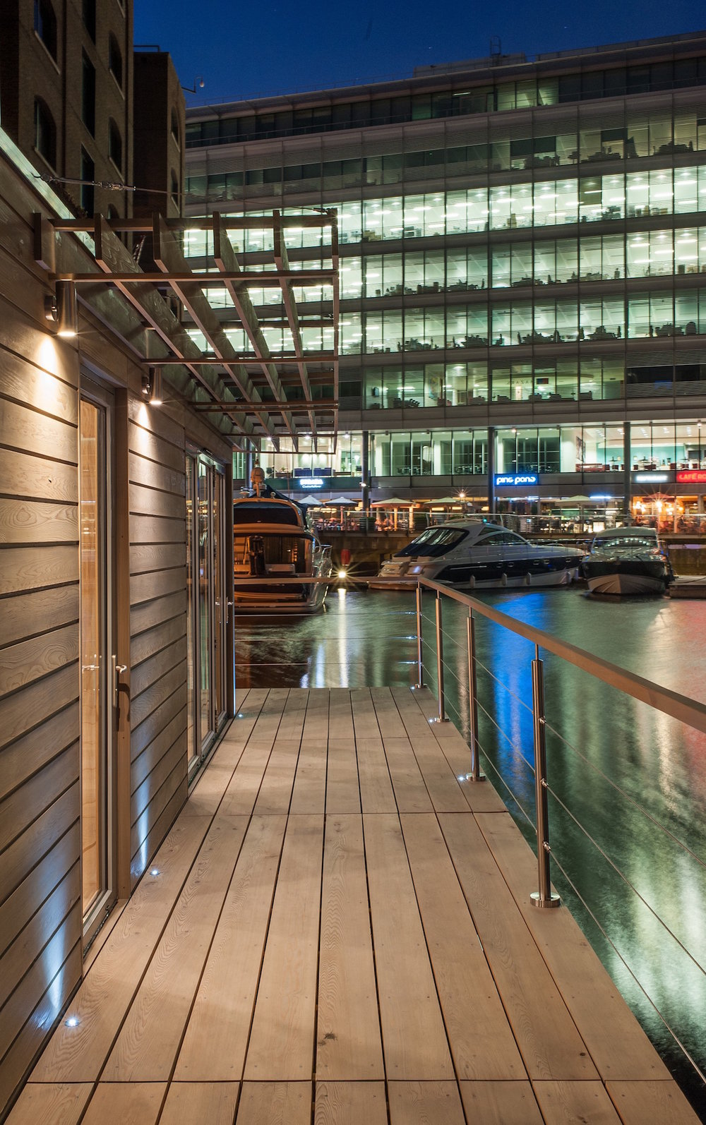 Night time floating office at St Katharine Docks