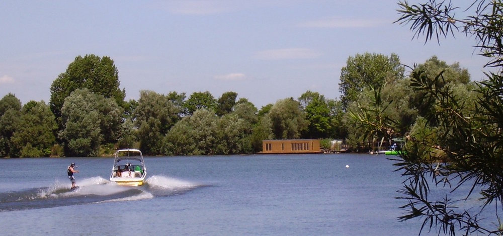 Wakeboarding at Eco Floating Homes Lake Home