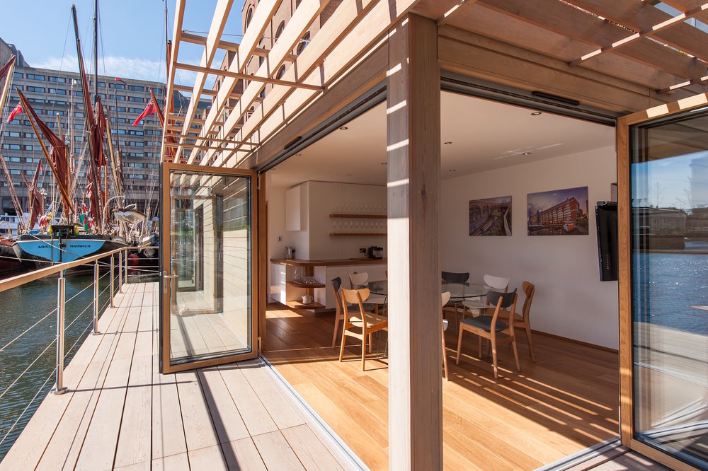 Cedar clad timber floating office , the Floating Hub at St Katharine Docks