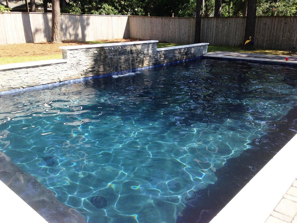 after northshore - Rectangle Pool With Water Feature