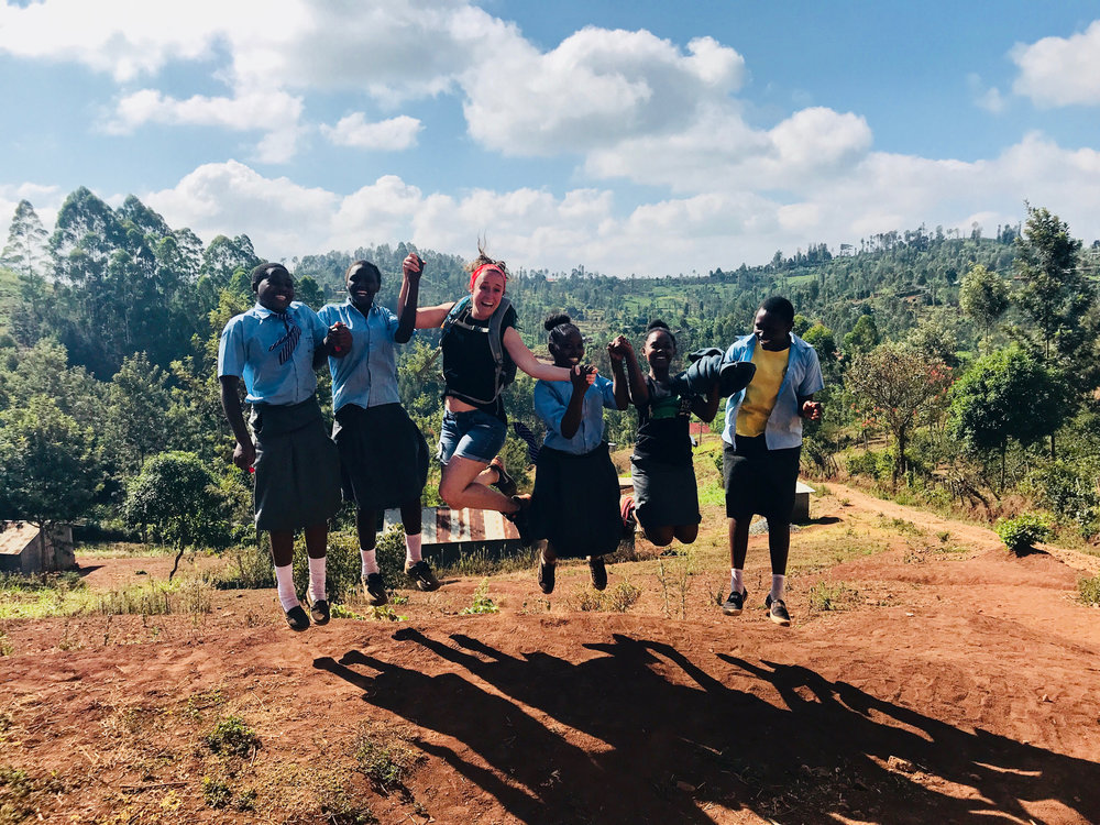Volunteer Lauren Eberhard with friends and students from Theri Secondary School.