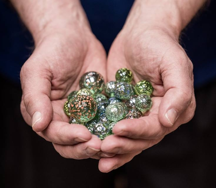A handful of the unique blue marbles we were offering to audiences during the 2018 Water Docs Film Festival.