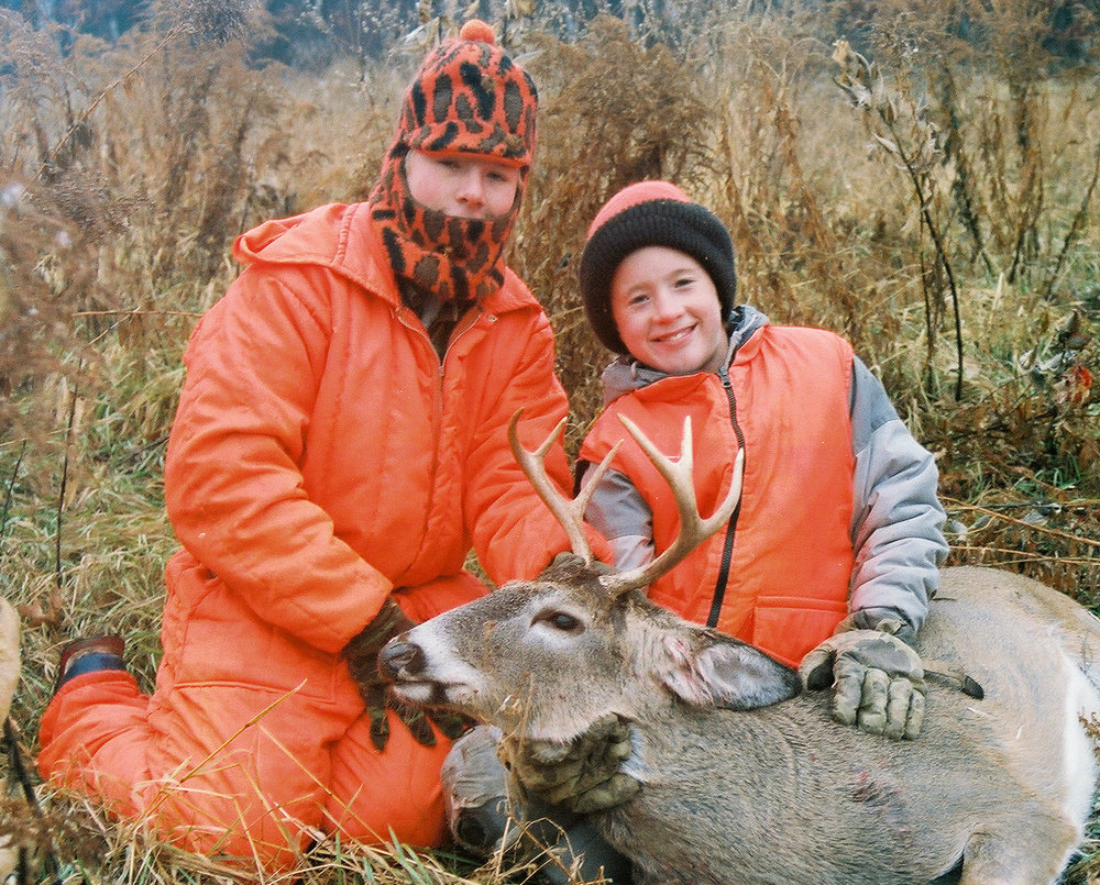 Bill with Casey, who is showing off the deer he helped Larre get