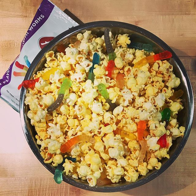 Movie nights in October call for worms in your popcorn! #gummyworms #popcorn #movienight #familytime #familymovienight #scarypopcorn #halloweentreats #albanese #albanesecandyfactory #albanesecandy