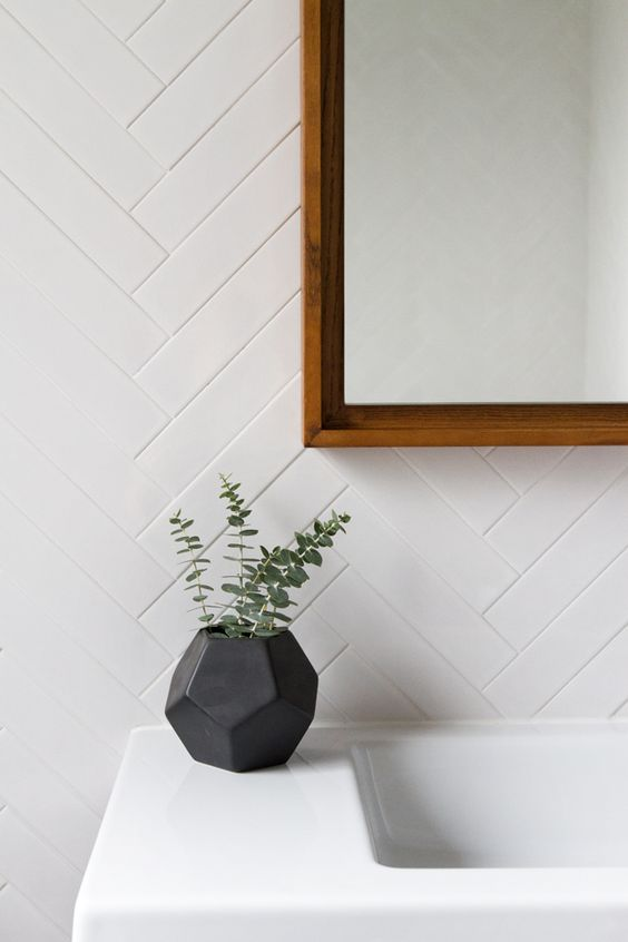 white herringbone wall tiles