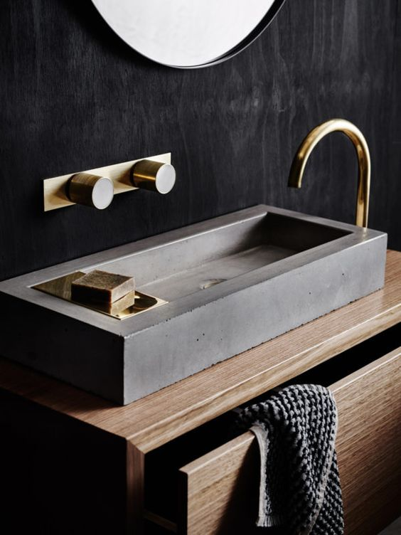 Concrete and brass bathroom