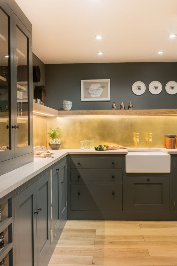 green kitchen with brass