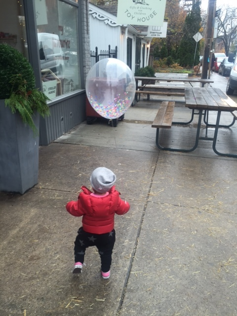 she loves balloons (did you know we sell and blow balloons up?)