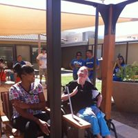 This is a resident at Hacienda in Phoenix enjoying their new wheelchair swing provided by funds from Squaw Peak Football Fever cards. The residents really enjoy a bit of normalcy in their play and the swing provides it.