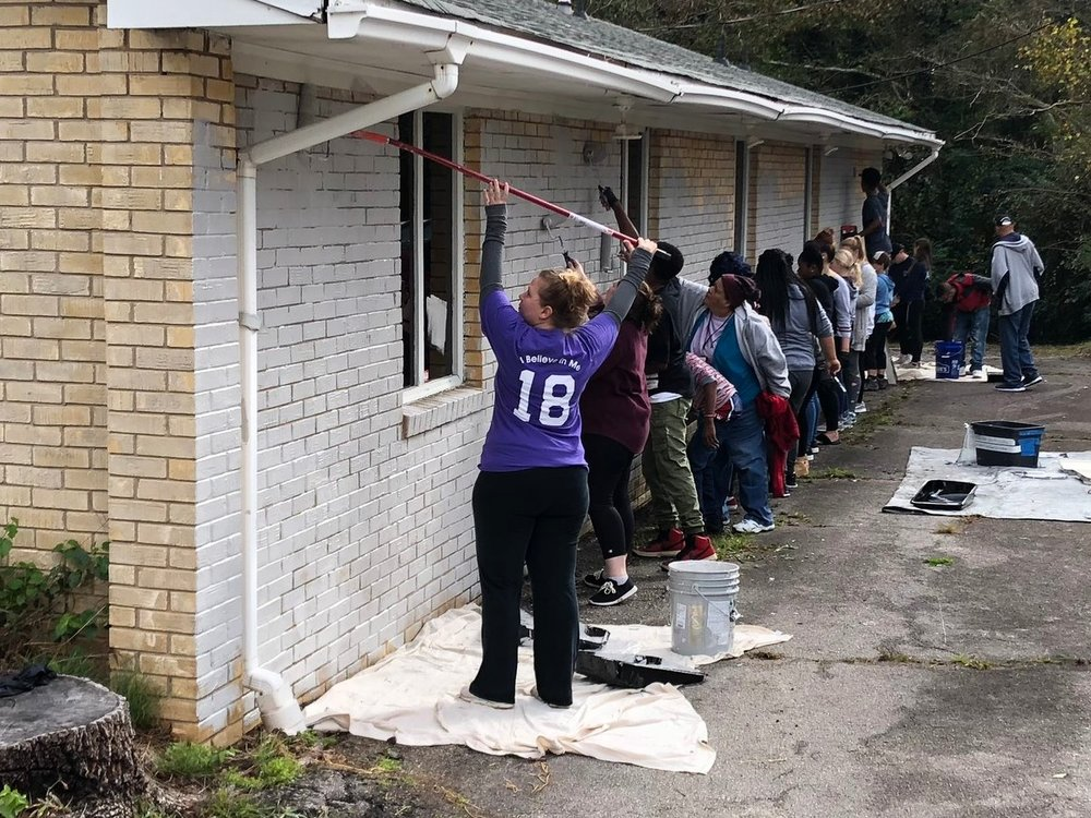 SaySo, LIFE Skills and community members work together to fix up the HUB Young Adult Resource Center.