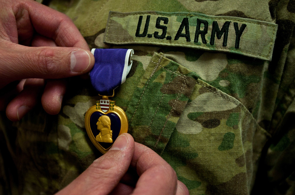 The Purple Heart for a wounded soldier via  Scout .com