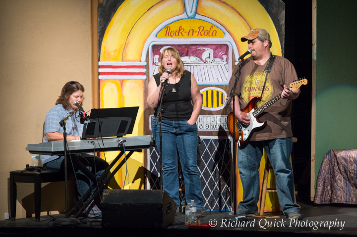Catherine Reed, Pearl Brick and Steve Zimmerman interweave music with the action on stage. Jukebox backdrop created by Danny Morris.