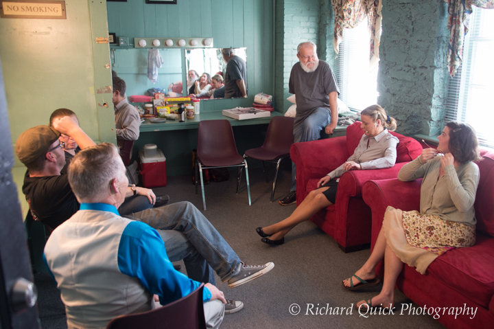 Director Larry Horns provides pep talk to cast in green room.