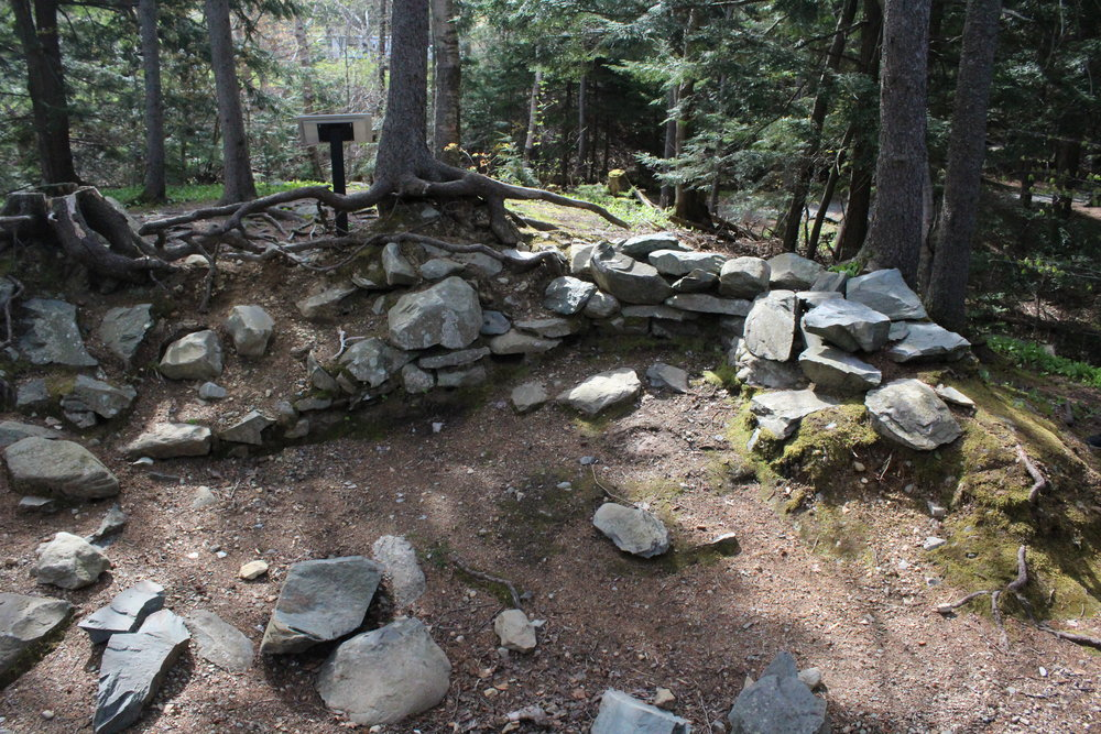In this photo you can see the remains of one of the buildings found along the trail in Shubie Park.