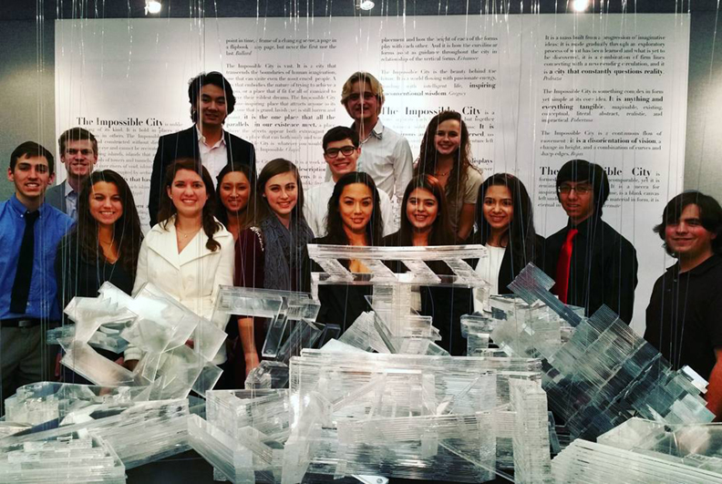 René pictured here with students from her architecture class at Texas A&M University. Although the profession has yet to catch up, there's more females than ever graduating with architecture degrees.