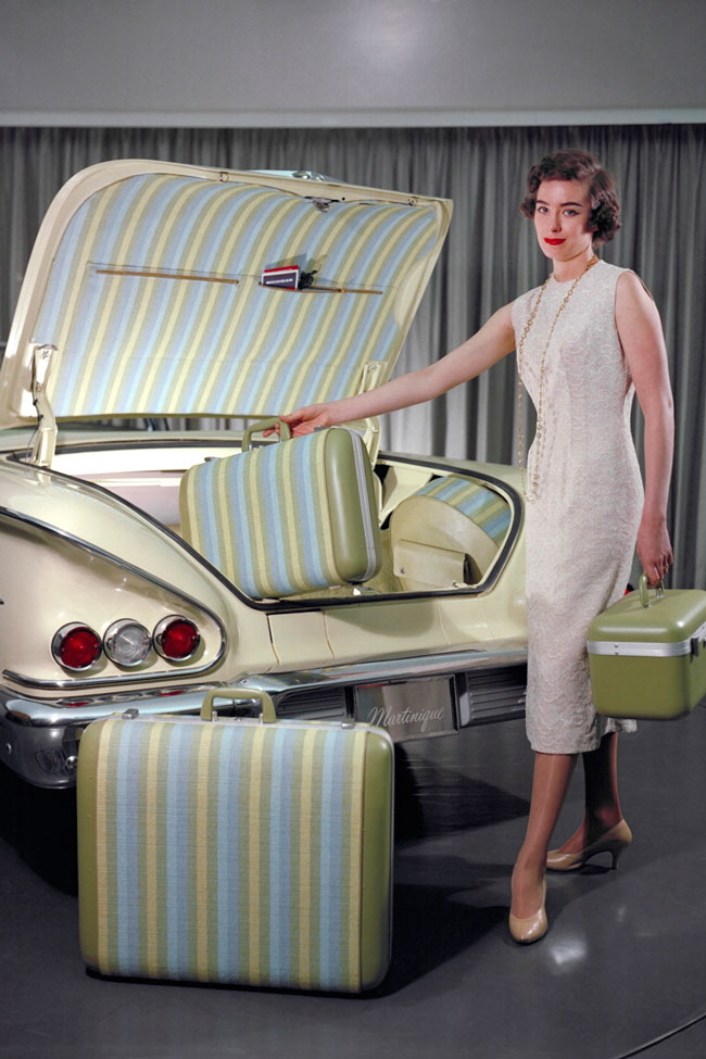 Linder loading a matching set of luggage into the trunk of her exhibition-model Impala Martinique