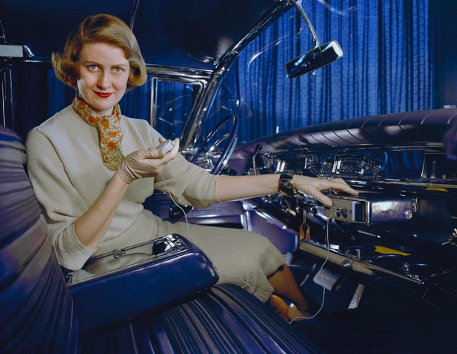Pohlman demonstrates the glove box dictaphone included in the exhibition-model of her Buick Shalimar.