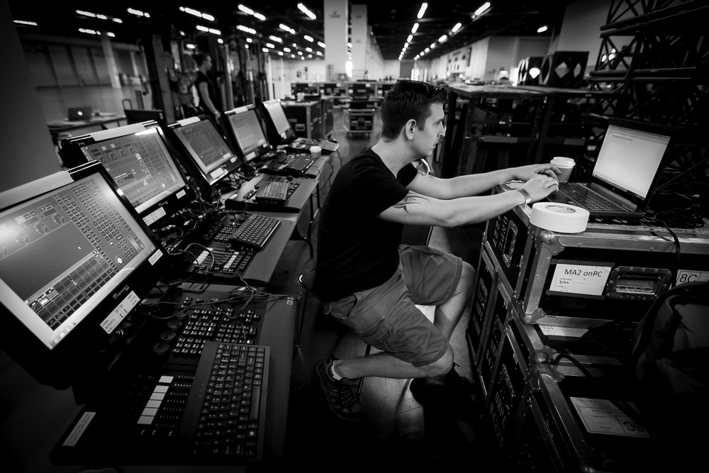 Matt Grinko seen here setting up the dozen or so lighting consoles that were used to control the automated lighting for an event at the Anaheim Convention Center.