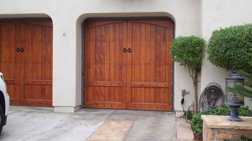 The Addition Of A Custom Wood Garage Door Brings A Rustic Elegance To The  Exterior Of Your Home. Reminiscent Of A Country Estate, A Vintage Wine  Cellar, ...