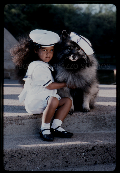 Schipperke dog with girl in sailor costume