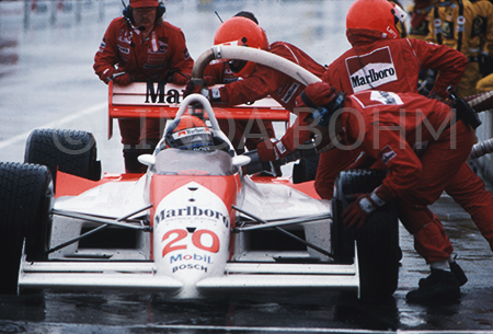 Emerson Fittipaldi racecar driver at pitstop