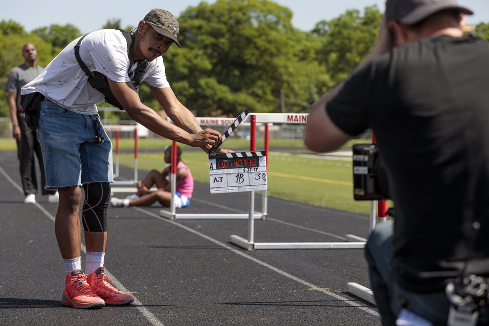 Roderick Reed (Second Assistant Camera) slates a scene.  Photo credit,  Steve Serio .