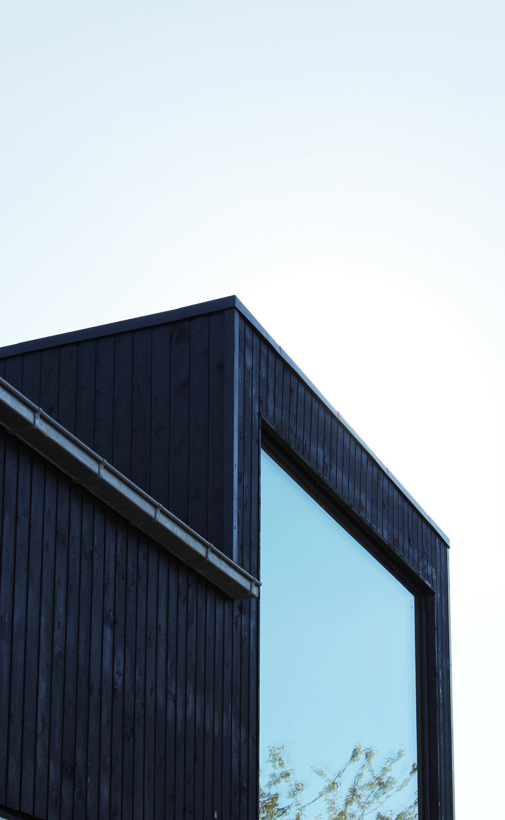 EXTENSION TO VILLA IN VIBY. New second floor in wooden cladding added to existing villa.