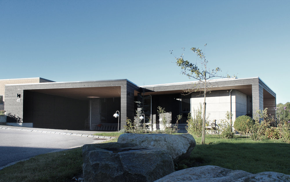 NEW PARKING, PATIO AND STORAGE FACILITIES ADDED TO EXISTING VILLA IN LYSTRUP.