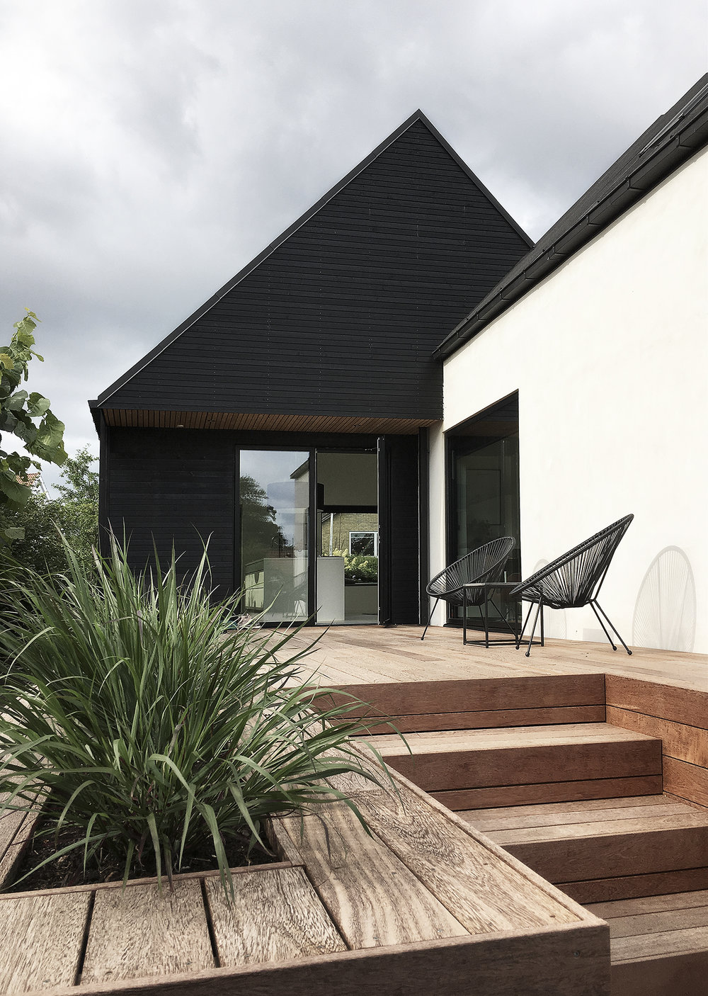 NEW EXTENSION, WOODEN TERRACE AND RENOVATION OF EXISTING HOUSE IN BRABRAND, AARHUS.