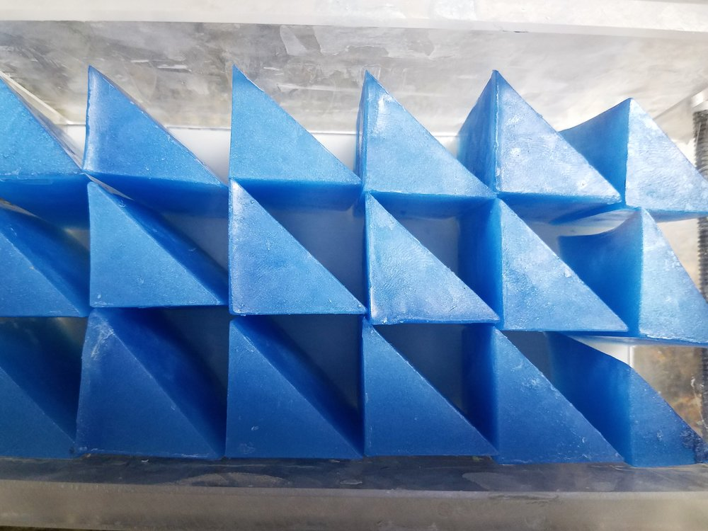 Melt and Pour triangle embeds lined up in the mold so that the points of each triangle touched.