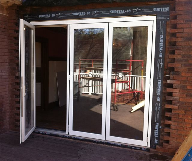 Here, SubSeal is being used as a flashing membrane around this french door renovation project. SubSeal is an excellent choice for flashing under masonry where high moisture content is present.