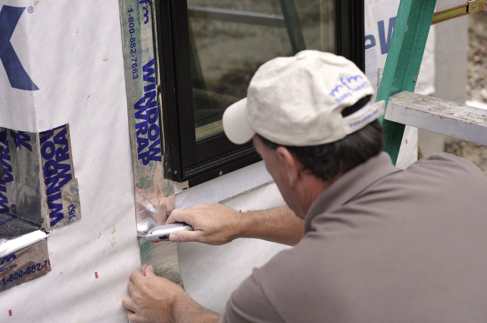 Make sure to extend the jamb sections of WindowWrap® past the bottom of the window. NEVER flash across the bottom window flange - it will trap moisture in the window cavity.