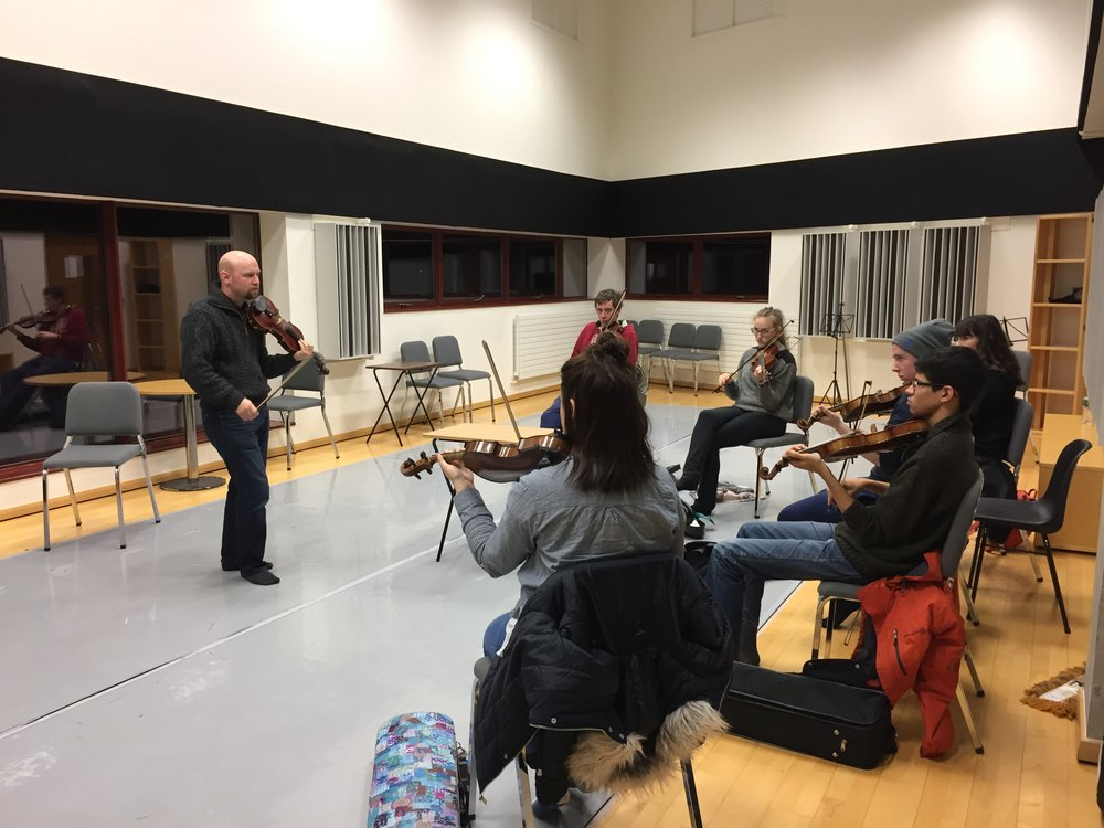Teaching fiddle masterclass to a group of Undergraduates at The Irish World Academy at the University of Limerick,  Ireland