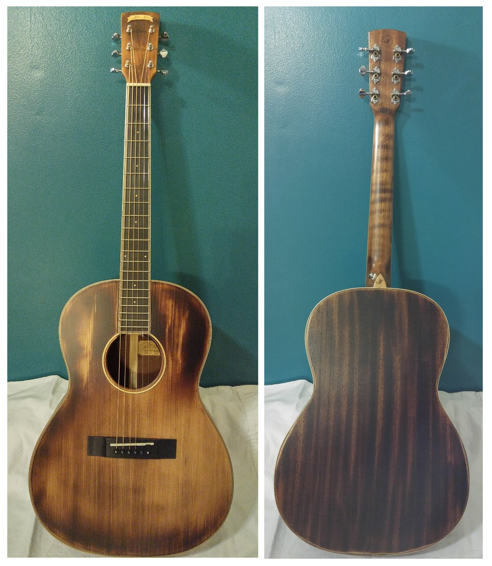 "Shape: 00, Top:  Solid Spruce, Back/Sides:  Mahogany, Fingerboard/Bridge:  Walnut, Nut/Saddle:  Bone, Finish:  Open Pore ""Distressed"""