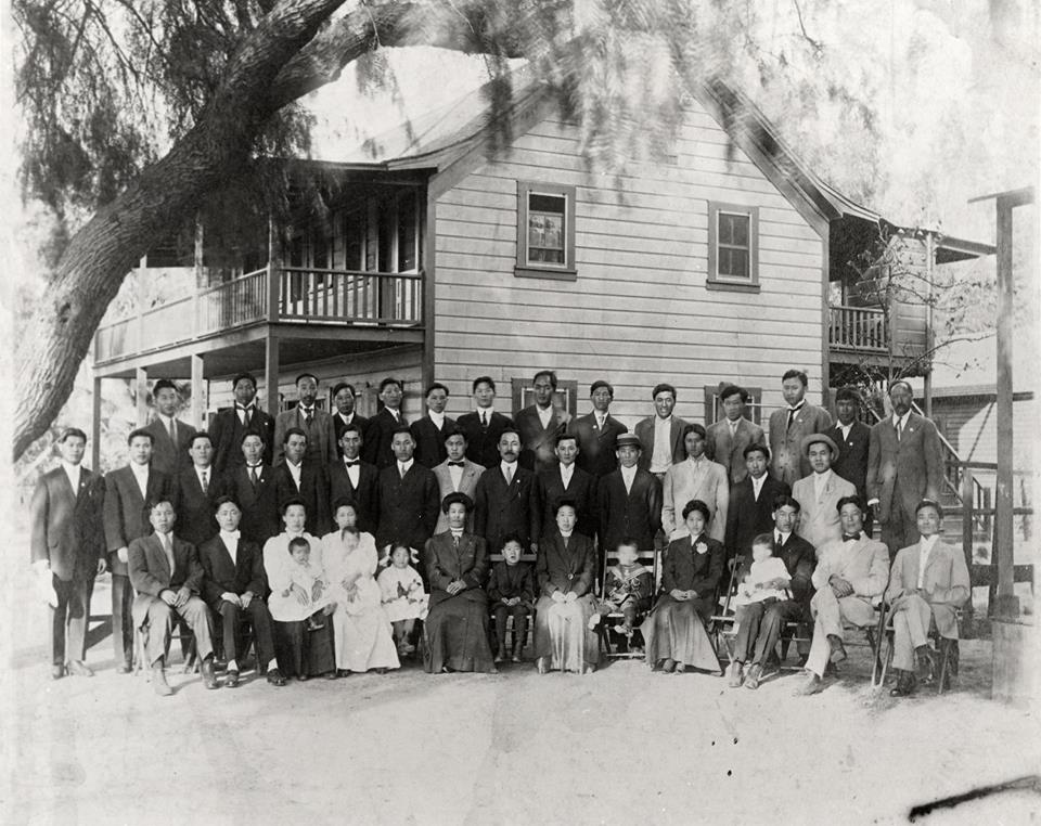 Riverside, CA |   Dosan came to Riverside in 1904 after organizing the first Korean community in San Francisco, where he formed the Chinmokhoe-Friendship Society. This picture is Dosan, Helen Ahn, and Philip Ahn with the Korean National Association at the Pachappa Labor Camp in Riverside. Pachappa was a Chinese railroad workers compound taken over by Koreans in 1905. A few years later in 1913, there was a deep freeze in Southern California damaging the regional agriculture industry. There was no work for Koreans in the orchards, so many moved to Los Angeles. Dosan moved to L.A. ending up in the house where his daughter, Susan Ahn Cuddy, was born at 1411 West Fourth Street off Lucas, two blocks from the Good Samaritan Hospital.