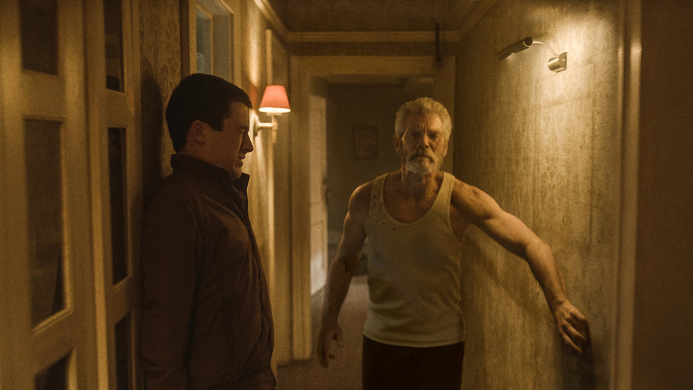 Dylan Minnette and Stephen Lang in  Don't Breathe  | Screen Gems