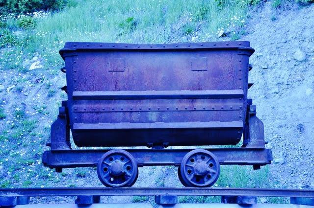 LEE ANN WOLFIN  Blue Ore Car Mixed Media 30 x 45