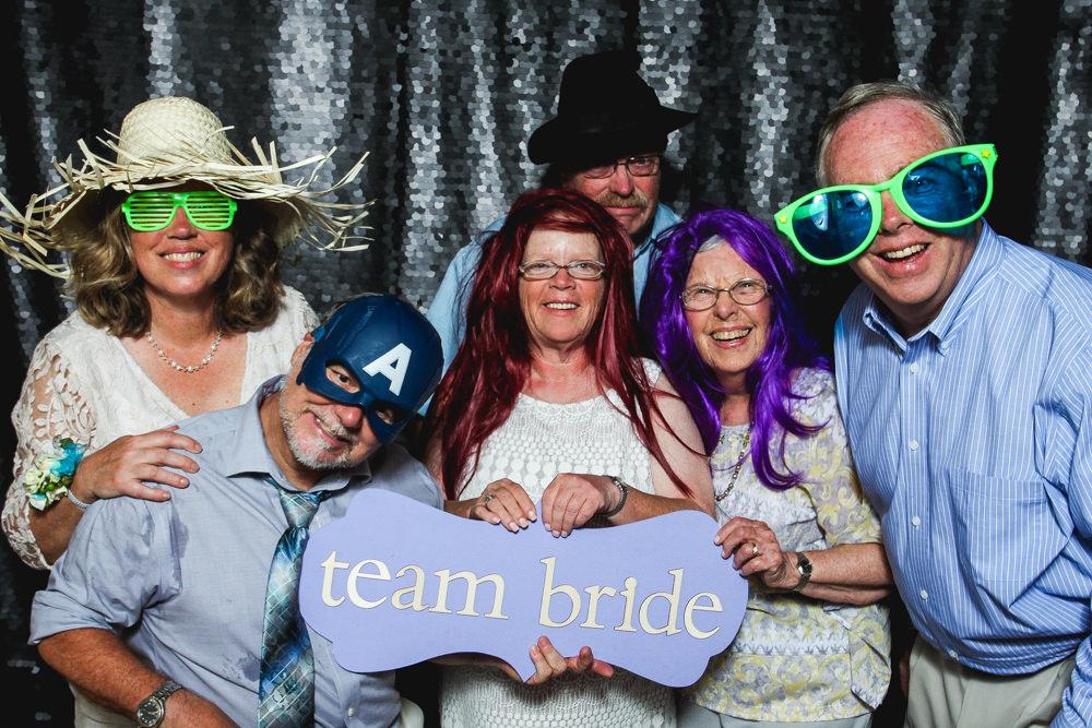 family-having-fun-in-photo-booth