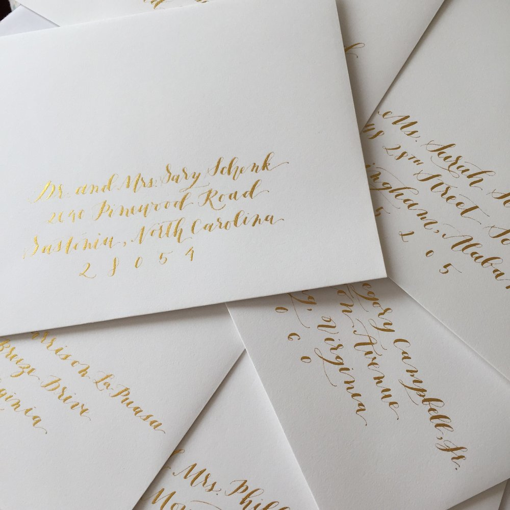 gold calligraphy wedding envelopes