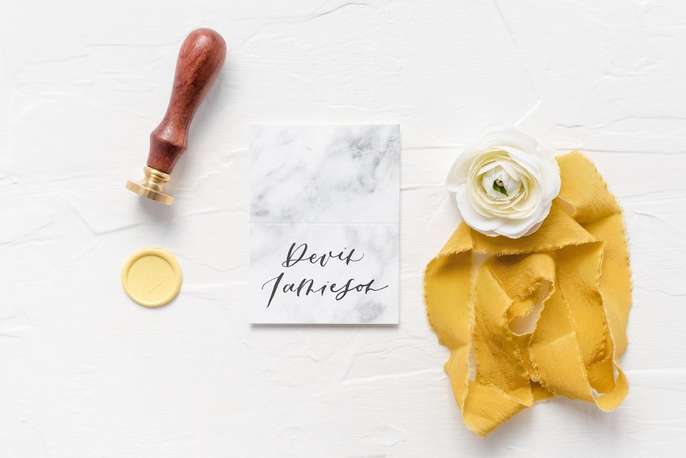 marble calligraphy escort cards
