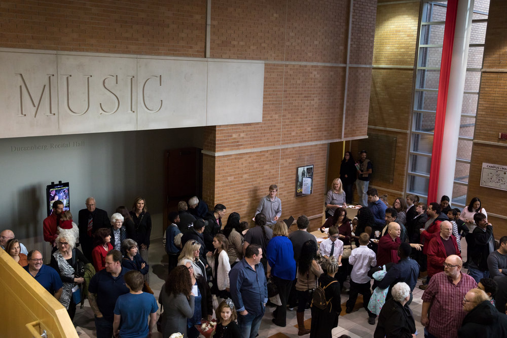 people gathered with music sign in backgroun-1.JPG