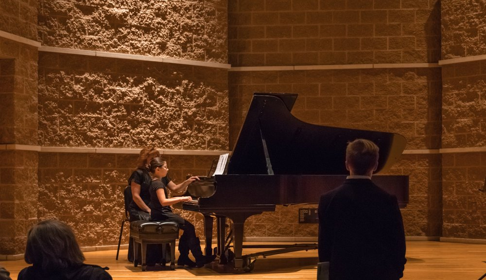 kid playing piano with janice with kid in foreground-1.jpg