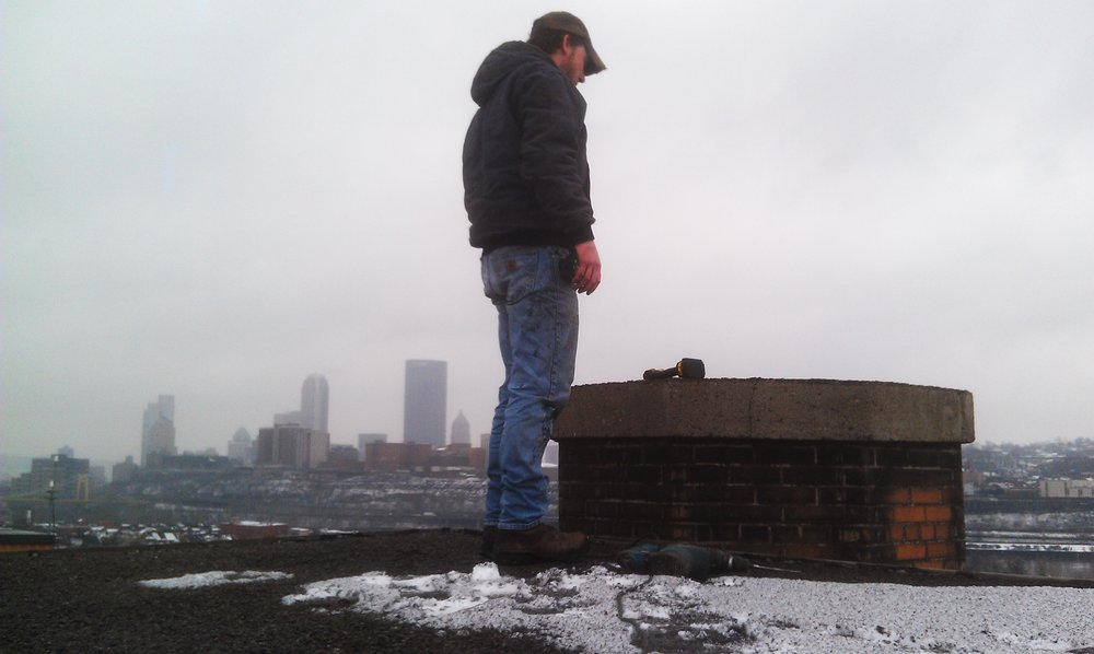 Zach standing above the skyline.jpg