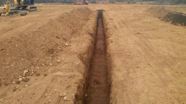 TRENCHING ...LEVEL AND STRAIGHT FOR UNDERGROUND UTILITIES
