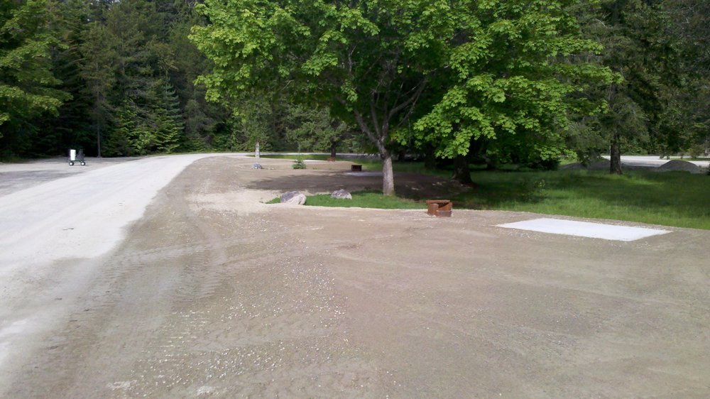 ROAD GRAVEL LEVELLED AND GRADED WITH EXCAVATOR BLADE.... NO OTHER MACHINE REQUIRED...