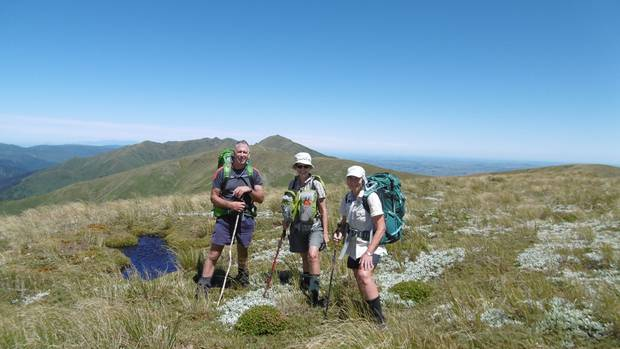 Calm before the storm on the Ruahine tops, from left, Mark Sutherland, Cherry Channon and Val Wackrow.