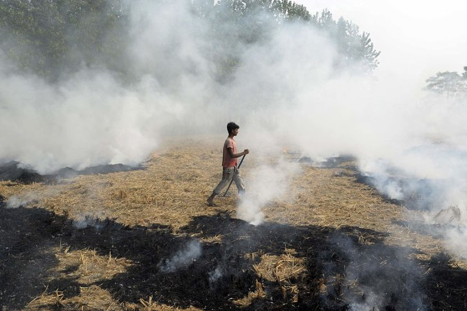 Burning paddies, like this one Thursday on a farm in the Indian state of Punjab, contributes to the poor air quality in New Delhi, the capital. (  Shammi Mehra/Agence France-Presse — Getty Images)