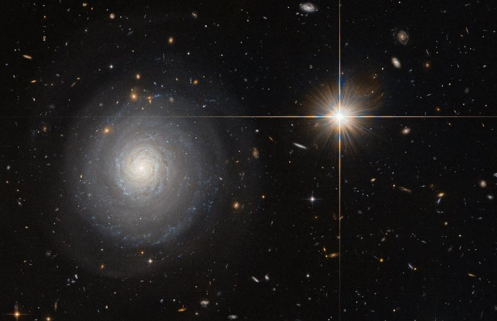 This image, taken by the Hubble Space shows a starburst galaxy named MCG+07-33-027some 300 million light-years away from us,