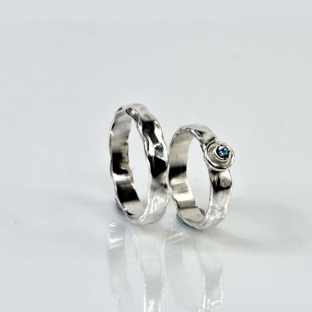 Bespoke commissioned silver wedding bands.